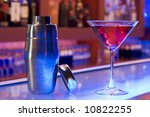 cocktail drink and shaker on a bar - stock photo