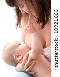 Breastfeeding. Low DOF, on breast and baby's eye - stock photo