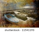 Photo of a four boats in stone harbor on grunge background - stock photo