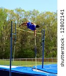male pole vaulting at a track and field competition - stock photo