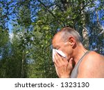 Middle aged man with pollen allergy - stock photo