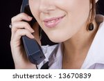 Close up of an attractive face answering the phone - stock photo