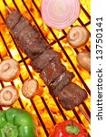 Beef shish kebab veggies on a fire hot barbecue grill. - stock photo
