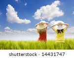 two girls in a wheat field, two friends enjoying the open air - stock photo