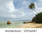 Seychelles seascape. Granite stones, palms and ocean. Anse d'Argent - stock photo