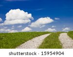 Tracked path through rural landscape - stock photo