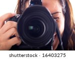 Young woman with digital camera taking picture - stock photo