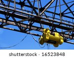 winch on gantry over blue sky - stock photo