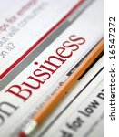 Business - newspapers business section and market analysis - stock photo