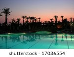 Illuminated swimming pool in Turkish resort by night - stock photo