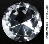 Round brilliant cut diamond isolated on black - stock photo