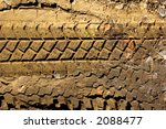tyre tread pattern in mud - stock photo