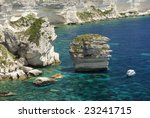 A boat in the sea in front of Bonifacio, Corsica - stock photo