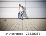 skater holding his skateboard while taking a break - stock photo