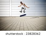 skater making a flip with his skateboard - stock photo