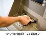 Getting Money (Euros) at a atm. Close-up. - stock photo