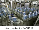 automated production line in modern dairy factory - stock photo