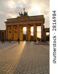 Brandenburg Gate with sunlight shining through - stock photo