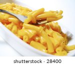 A forkful of macaroni and cheese - stock photo