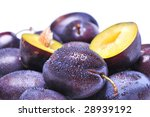 Wet plums on white background - stock photo