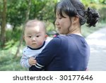 cute baby boy  with his mother - stock photo