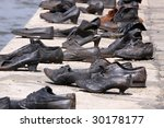 Shoes on the Danube is a memorial to the Budapest Jews who fell victim to the Arrow Cross militiamen in Budapest. - stock photo