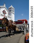 A horse-drawn carriage in front of the Juayua Church in El Salvador - stock photo
