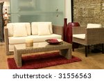 Modern living room with sofas from rattan and arm chair. - stock photo