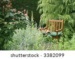 Chair in an English garden. Horizontal. - stock photo