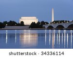 Evening view of the Lincoln Memorial and Washington Monument reflected in the Potomac River. - stock photo