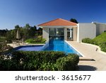 Residential housing development-Club House with swimming pool - stock photo