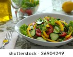 Salad from vegetables (tomatoes, cucumbers, pepper, salad, an onions, fennel). - stock photo