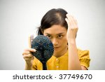 Portrait of Young Woman with a Bald Problems Grooming using Hand Mirror and Hairbrush Isolated on White - stock photo