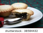 A tasty display of festive Christmas mince pies on a plate - stock photo