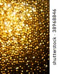 Abstract golden background of sparkling Christmas lights - stock photo