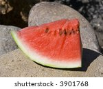 Ripe red watermelon on summer day - stock photo