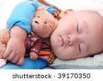 cute little baby boy sleeping quietly - stock photo