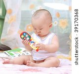 cute baby boy playing toy - stock photo
