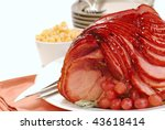 Freshly baked Easter spiral cut ham with honey brown sugar glaze - stock photo