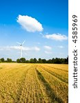 A windmill standing in a field - stock photo