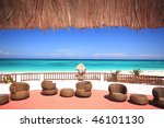 Tourist resort balcony overlooking a stunning tropical beach - stock photo