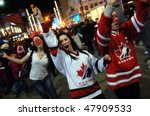 VANCOUVER, BC, CANADA - FEBRUARY 28: Canadians celebrate Canada Hockey Team Gold Medal win at 2010 Winter Games, February 28, 2010 in Vancouver, BC, Canada - stock photo
