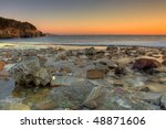 River flowing to the ocean early on a winter morning. - stock photo