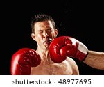 boxer actually being hit, studio shot - stock photo