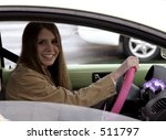 Young woman behind wheel of car - stock photo