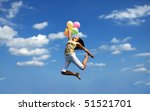 young woman flying with colorful balloons - stock photo