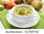 Cream of potato soup with vegetables and Vienna sausages - stock photo