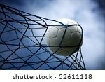 a soccer ball in the goal - stock photo