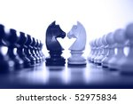 chess knight challenge selective focus blue tone - stock photo