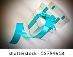 Beautiful white present gift box with blue ribbon - stock photo